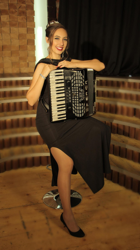 How to hold the accordion while sitting on a barstool